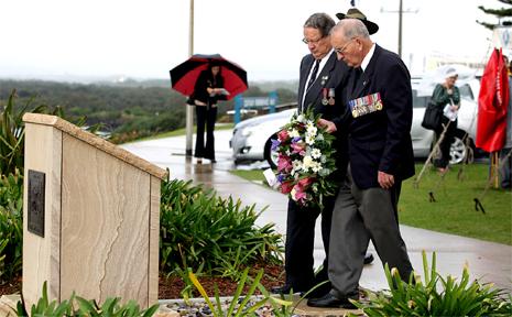 National servicemen unveil a memorial on Point Danger.