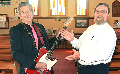 RON Kitchin and Father Ken Spreadborough rock out in church for Wintersun.