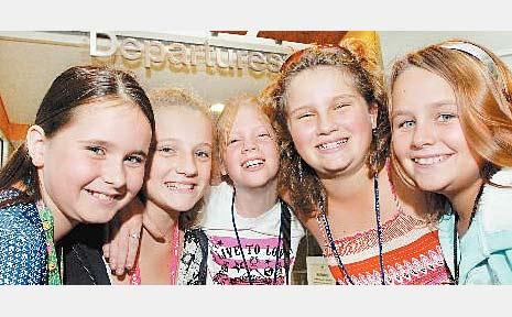 Swayneville State School students, from left, Zoe Davidson, 10, Reilly Bollard, 9, Zahna Jones, 10, Olivia Bollard, 10, and Bridget Matton, 11, at Mackay Airport yesterday.