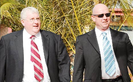 Lawyer Bill Morland, right, leaves Mismore Local Court yesterday with his representative James Fuggle.