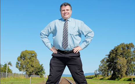 Member for Dawson James Bidgood stands by the move to install safety boom gates at a Bakers Creek level crossing.