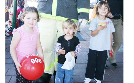 'Bernie Cinders' from the NSW Fire Brigade was popular with the children at the Old and Gold Festival on Saturday. He is joined by (from left) Danielle Mathie, 3, of Bangalow, and Sara, 2, and David Irace, 4, of Brunswick Heads.