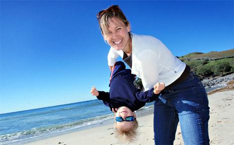 Rebecca and Lakota Sutcliffe enjoy some warm winter sun at Cabarita Beach.