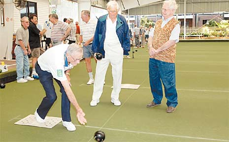 Henry Kingston bowls while Robert Long and Alastair Mackenzie check his action. The three men yesterday spoke ot the Daily Mercury about the negative stereotypes that are often associated with older drivers.