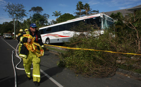 Firemen secure the accident area after a Blanch's bus ran off the road in Browning Street, Byron Bay, on Sunday afternoon. Photo: Jann Burmester.
