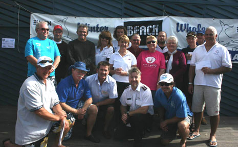 Byron Bay Winter Whales members and representatives of 17 local charities and clubs attend the presentation of cheques at Byron Bay last Sunday.
