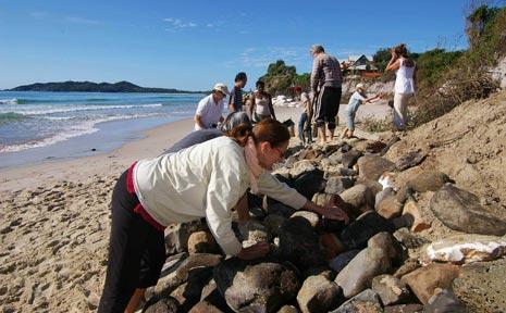 Residents hard at work on Saturday restoring access to Belongil Beach.