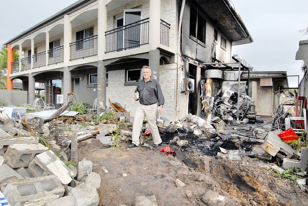 Keith Ryan surveys the damage after a truck ploughed into his motel on Nebo Road in 2009, sparking the ring road push.
