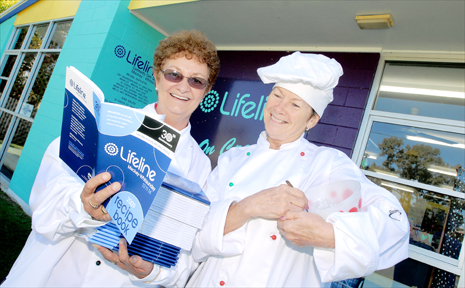 Lifeline Mackay and Whitsunday's Marianne Booth and Dorothy McLean check out the warm chicken salad recipe in the cookbook 'A Plate of Volunteers' which has been produced to celebrate the organisation's 30 years at Mackay.