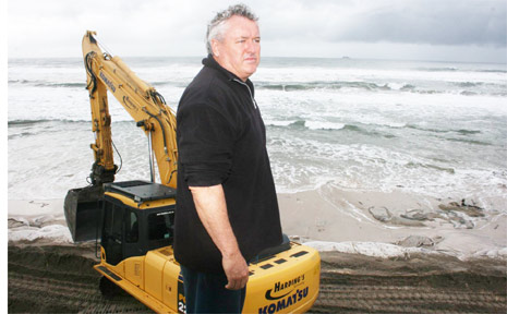 Belongil Beach home owner, John Vaughan, inspects progress of protection works on Monday.