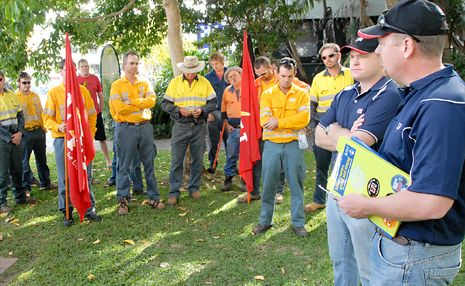 ETU organiser Stuart Traill, far right, with Allen Hicks, second from right, address the troops in 2009 at the protest rally against Queensland Government's plans to sell public assets.
