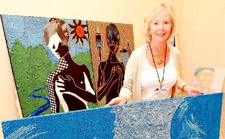 FRIENDS of the Tweed Art Gallery volunteer Maureen Brack shows off one of Joe Miller's self portraits.