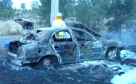 CRISPY CAR: Two Moura teens escaped a car fire on Moura-Theodore Road on Sunday after the driver left the road and stopped in the grass. Heat from the engine started a grass fire which destryed the car.