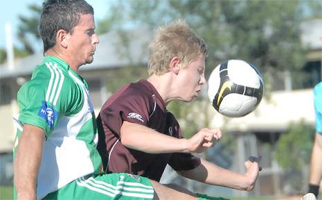 Miners' Ben Schaper and QAS's Matt Thurtell battle for the ball.