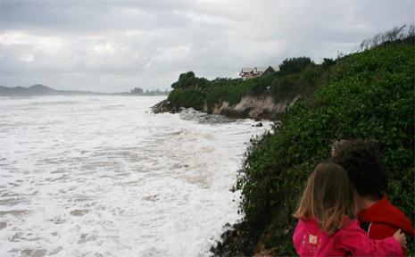 A surging sea threatens property at Belongil Beach during recent big seas.