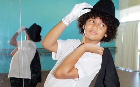 Zeak Tass, 13, mirrors Michael Jackson's trademark white glove.
