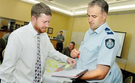 Queensland Transport safety manager Colin Edmonston and Crime Prevention officer Sergeant NIgel Dalton at the road safety workshop yesterday.