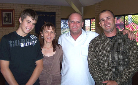 Andrew Saxelby (second from right) with his sons Reece (left) and Ricky and wife Kerri.