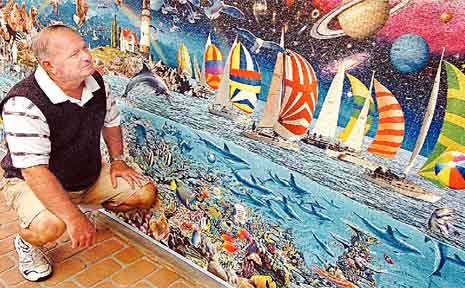 Hervey Bay's Allan Sellke has a big addiction to big puzzles, especially after finishing the world's biggest commercially available jigsaw puzzle.