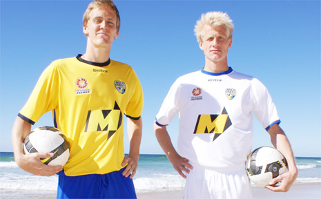Players Michael Thwaite and Bas van den Brink model Gold Coast United's home and away playing strips.