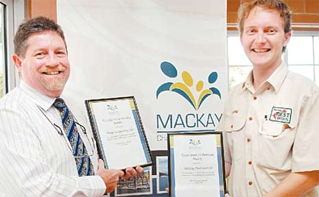 Magpies Sporting Club general manager Chris Bekkeli and Lawrie Williams from Mackay Pest Control are presented with Excellence in Service Awards at the Mackay Chamber of Commerce members' lunch yesterday.