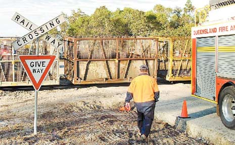 A man narrowly missed being flattened by a cane train yesterday morning when his car stalled at a railway crossing on Mackay-Eungella Road.