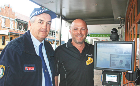 Cocomangas licensee Gary Charles (right) and Inspector Owen King inspect the new identification scanner outside Cocomangas Nightclub in Byron Bay.