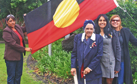 Raising the flag for Naidoc Week are (left to right) Yvonne Stewart, Auntie Dulcie Nicholls, Delta Kay and Val Saunders.