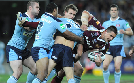 Queensland prop Steve Price is tackled during Queensland v New South Wales State of Origin Game 3 at Suncorp Stadium in Brisbane.