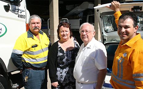 Ergon Energy Sarina acting work group leader John Tighe, left, and area operations manager Lawrie Zarb, right, with Sarina Meals on Wheels treasurer Christine Hixon and president Dallas Simonsen.
