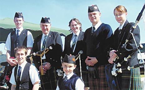 Celebrating everything Scottish are (back, from left) Ben Tomkins, Bruce Schelbach, Kelly Nielsen, Sandy Dalziel, Petrina Davis, (front) Alexander Manfield and Jacob Chalk at Scots PGC on Saturday.