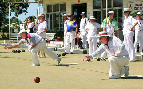 Marian members Fred Harberger, on the mat on the left, and Nev Ingram, on the right, deliver their bowls during the club's birthday carnival on Sunday.