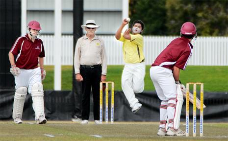 NQ batsmen Matthew Burton, far left, and Tony Hampson, far right, await the ball from Delhi bowler Mayur Sharma.