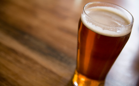 A man has been arrested after he threw a schooner of beer at a Casino publican.