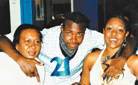 A PICTURE of Janeese Corowa with her two children, Robert and Emily Corowa, at Robert's 21st birthday party.
