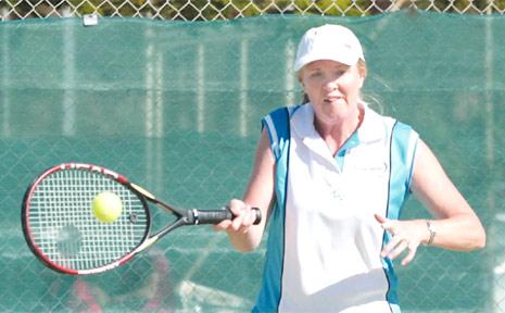 HITTING her stride is Tweed's Debbie Teitzel in the over-45 ladies' doubles.