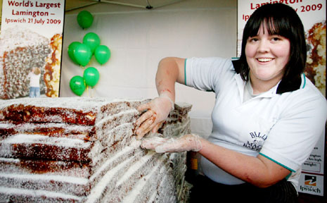 Billy Mac's bakery assistant Emily Dwyer puts the final touches on the world's largest lamington.