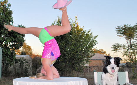 NEW TRICKS: Alex Gentle tries to coax her dog Delta into preparing an act for the upcoming Moura's Outback Talent Quest.