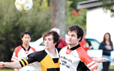 Goonellabah's Sam Dwyer and Burringbar's Luke Callaghan contests the ball in the Football Far North Coast First division match won by Burringbar 2-1 on Saturday.
