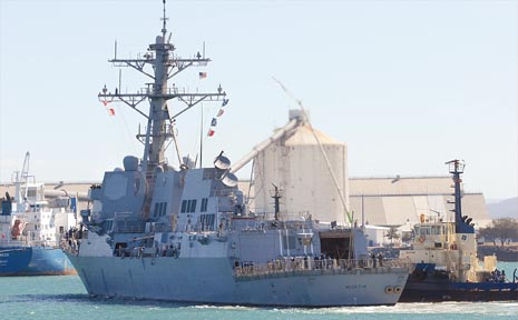The guided missile destroyer USS Mustin docks at Mackay harbour late yesterday afternoon.
