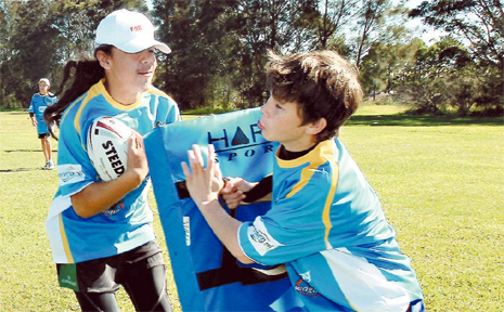 NSW PSSA Open Rugby League players Setali Tevi-Fuimoano and Jack Cogger go through a drill at St James Primary School.