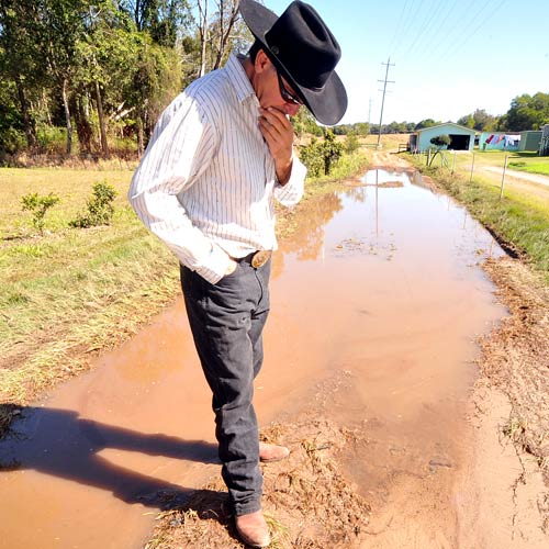 Three Days On: Michael Sekulick inspects the water leak he reported to the council on Friday. Photo:Warren Lynam/184055