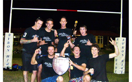 The Byron Bay Boardriders team celebrates its win in the A grade touch football finals.