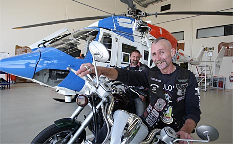 Trevor Skoupy and Lester Duggan of the Black Uhlans are preparing for the Sunshine Coast Hinterland Poker Run from which part proceeds will go to AGL Action Rescue Helicopters.