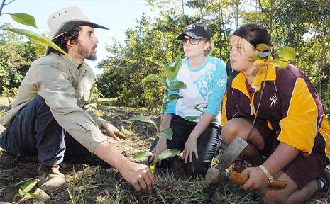 Mackay Greens candidate Jonathon Dykyj demonstrates to Sarah Matheson, from Mackay Toyota, and Sarina State High School student Xrystle Tonga how to plant a tree at the Eulbertie Reserve yesterday.