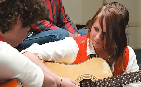Matt Walters from Gladstone and Jaimee Cox from Winfield play along to their newly-created song during the song the Song Trails workshop, at the Bundaberg Civic Centre yesterday.