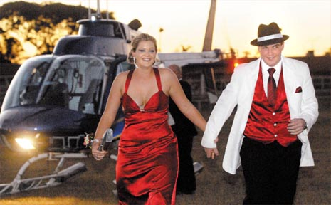 Cassandra De Waard and Sheldon Cowan step out of a helicopter after flying above the new MECC, where their school formal was held on Saturday night.