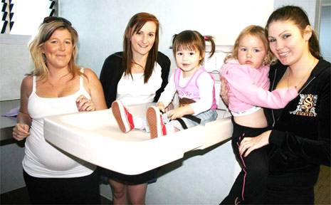 Pictured at the new baby change table in the toilets at Apex Park in Byron Bay are (from left) Kristy Charles, Eliza Brunell and her daughter Layla Evans 2; Josie Walton and her daughter Amelia 3.