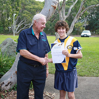 Coolum High's Jakson Shearer thanks Coolum Beach Bowls Club board chairman Ray McKenzie for the club's support of the school's rugby league team.