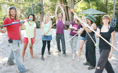 Instructor Simon Fooks (left) teaches a fire twirling class at the Arts Factory Village in Byron Bay.